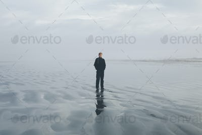 Middle aged man standing on a beach at Seabrook, Washington, USA.