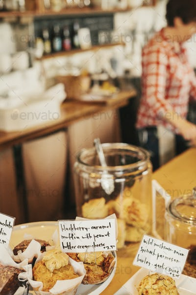 Freshly prepared food on the counter of a small coffee shop and restaurant. Hand written labels on