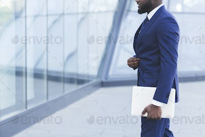 Unrecognizable Business Man Holding Digital Tablet Walking In City, Cropped
