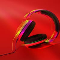 Stereo Headphones on red color background. Glitch effect.