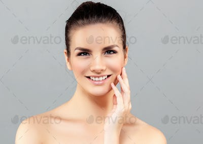 Beautiful woman face studio on white with sexy lipsBeautiful woman face studio on gray