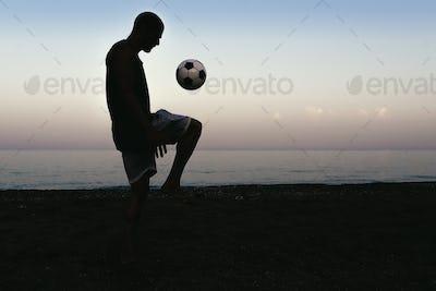 Man playing soccer.