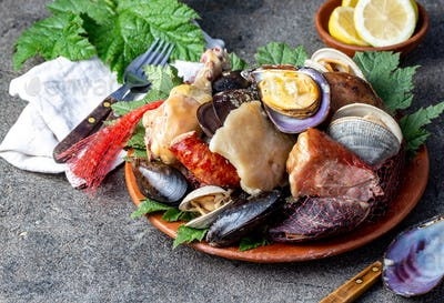 Curanto Kuranto. Different seafood and meat cooked in a pit on the coals under the ground