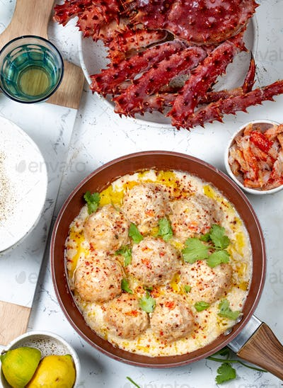 CRABMEATBALLS crab meatballs in white creamy sauce in red pan