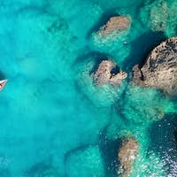 Yacht in the bay. View from the air. Travel image