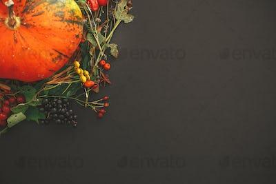 Autumn flat lay. Pumpkin in autumn wreath of fall leaves
