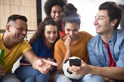 Group of friends watching something funny on the phone