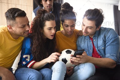 Group of friends watching something surprising on the phone