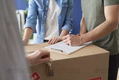 Couple signing a house purchase agreement