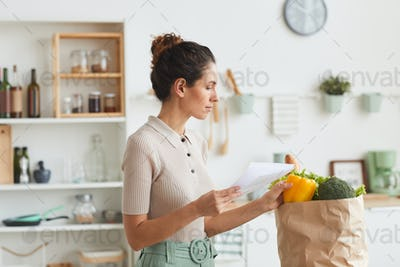 Woman checking the list after shopping