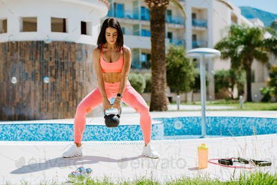 beautiful athletic woman Kettlebell Workout