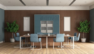 Modern boardroom with blue furniture and wooden panel on background