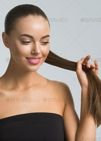 Woman skin care hair long beauty brunette hair natural skin make up blue background female portrait