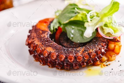 Close up of cooked octopus in a restaurant serving