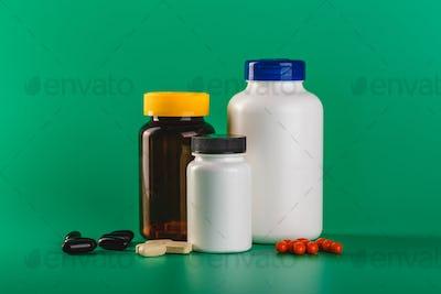 Bottle and Pills On green Background. Medicine Healthcare Pharmacy Concept. Coronavirus.