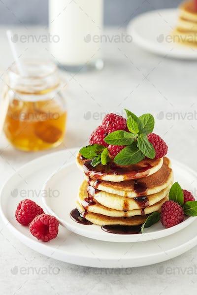 Sweet pancakes with raspberry