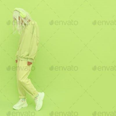 Fashion Dj Girl in Fresh yellow clothing. Minimal aesthetic monochrome design.