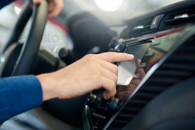 Male hand touching car sensor panel