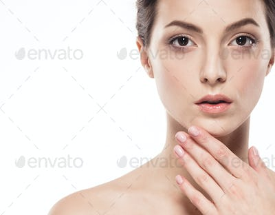 Young beautiful woman with hands  portrait with healthy skin studio on white