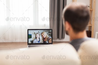 Man in a video call with his family