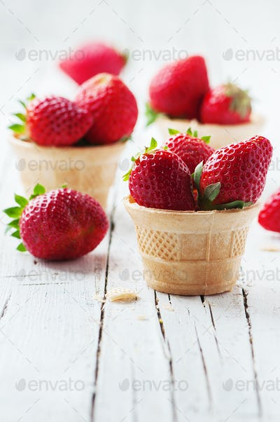 Sweet red strawberry on the wooden table