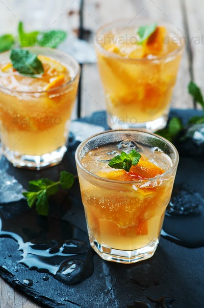 Fresh cocktail with orange, mint and ice