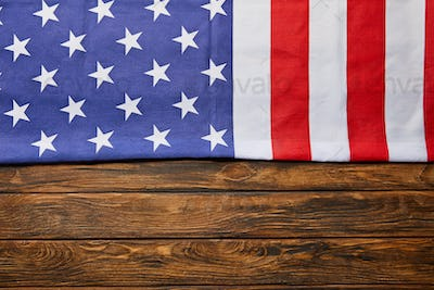 Top View of Usa Flag on Wooden Brown Background With Copy Space