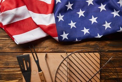 Top View of Crumpled American Flag And Bbq Equipment on Wooden Rustic Table