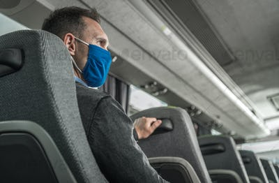 Men in Safety Breathing Mask on His Face Traveling Alone in a Bus Coach