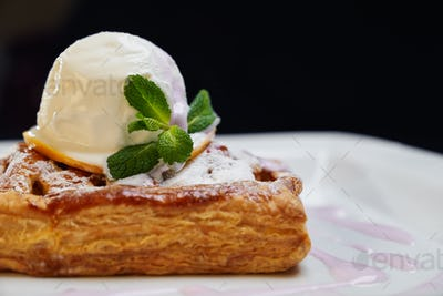 Cake with ice cream on plate