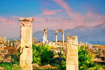 Ancient city of Hierapolis and a statue of Pluto or Hades at dawn