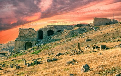 Antique city of Hierapolis under dramatic sunset sky