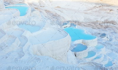 Blue water in the Pamukkale travertine pools