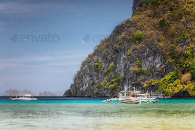 Boat in lagoon of Corong beach in El Nido, Palawan Island, Philippines