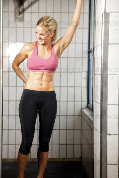 Happy Fitness Woman in Gym