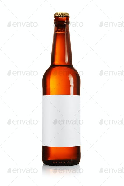 Brown beer bottle with blank label isolated on white.