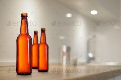 Brown beer bottles on kitchen table mockup.