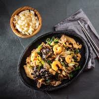 Chinese food. Te pam sao. Pan of fried different meat, shrimps shiitake mushroom