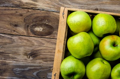 Box of fresh green apples. Harvest concept. Top view