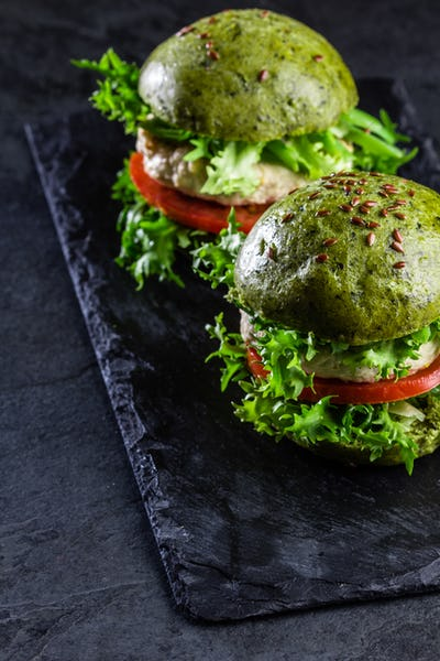 Green spinach buns and chicken burgers