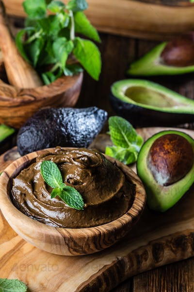 Avocado chocolate mousse in olive wooden bowl