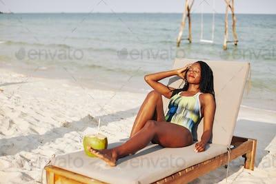 Sunbathing beautiful young woman