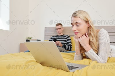 Woman watching new episode of show