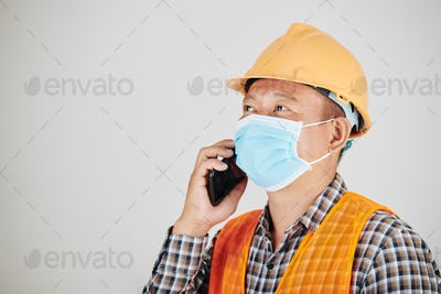 Construction worker calling on phone