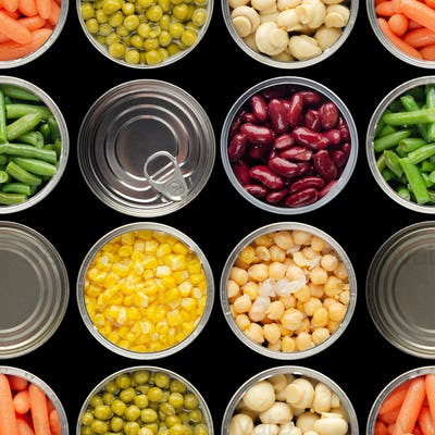 Seamless food background made of opened canned veggies