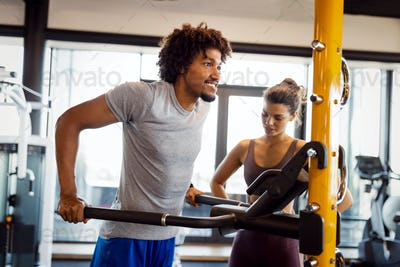 Teamwork in gym. Couple working exercise together
