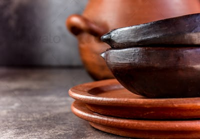 Kitchen background with copy space. Clay rustic kitchenware - pot, bowls and plates