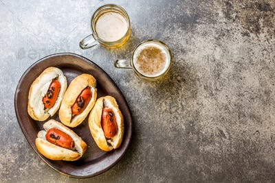 Choripan. Latin American Argentine and chilean food. Grilled chorizo sausages hot dogs served with