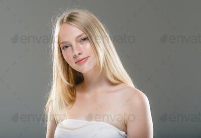 Natural long smooth hair woman blonde face clean skin