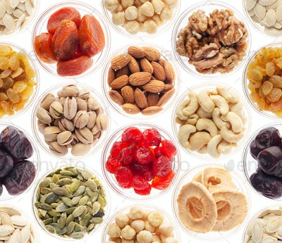 Seamless food background made of nuts, dried berries and dry fruits on white